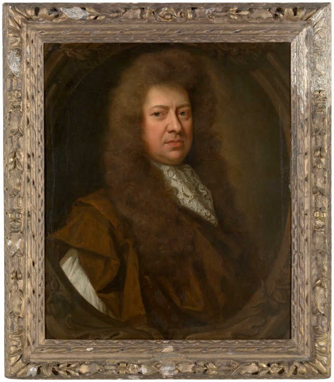 Portrait of Samuel Pepys in old age, wearing a wig and facing right against a dark background, in a gold frame.
