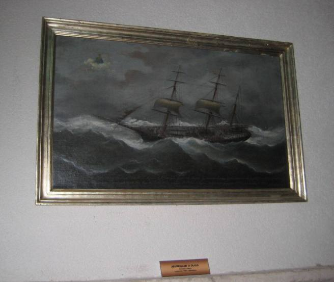 'Sailing ship in a storm', Ivankovic, 1887, ex voto painting in the cloisters at Kuna Peljeska, Croatia. Note the small saint on a cloud towards top left, rendering divine assistance, typical of such scenes, while the ship wallows in the sea, having lost most of her sails. The  associated church contains many silver ex voto plaques, many with shipwreck scenes.