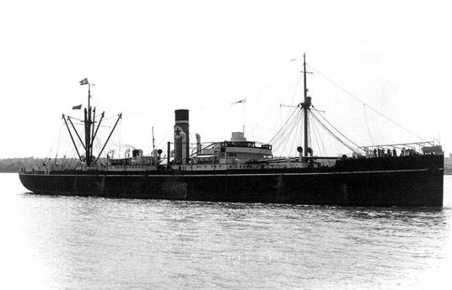 Black and white photograph of steamship in side view, depicting a star logo on the funnel amidships.