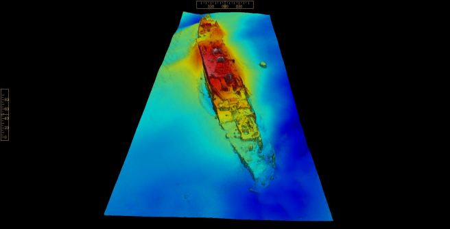 Three-dimensional colour image of wreck on the seabed, picked out in contrast colours modelling the wreck, with dark blue the seabed, light blue the lowest point and red showing the highest points of the wreck.
