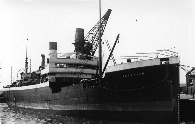 Black and white photograph of a ship with the name Algerian in letters beneath the bows,