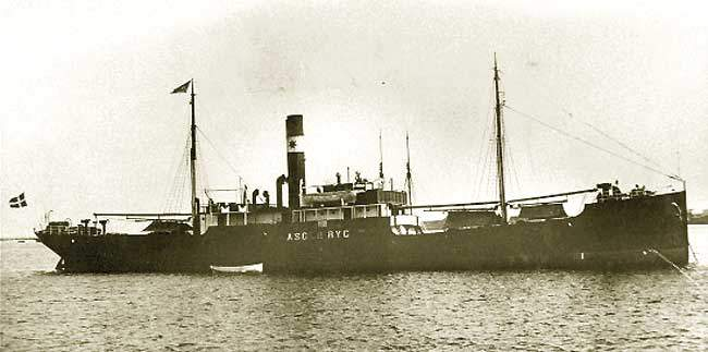 Black and white profile view of steamship with single prominent funnel.