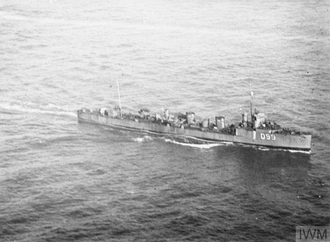 Black and white photograph of warship at sea in the lower half of the photograph, seen in starboard view, bows towards the right of the image.
