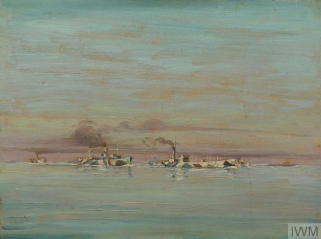 A convoy of dazzle camouflaged ships in the lower third of the painting, against a blue sea and a blue sky with pink and orange tinges to the clouds and on the horizon.