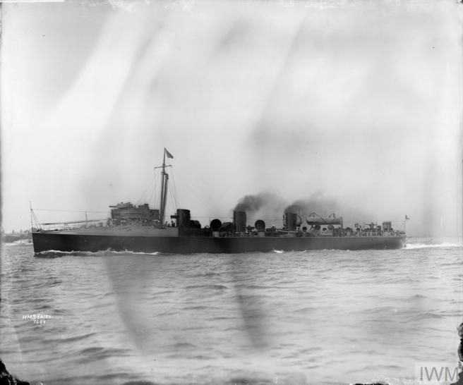B&W photograph of ship in port broadside view, smoke billowing.