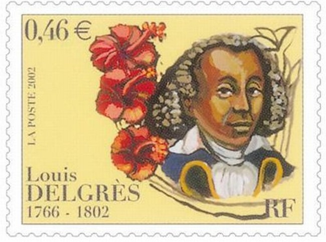 Postage stamp with bust of man in wig and military uniform on right, flanked by red hibiscus flowers, on a creamy yellow background.