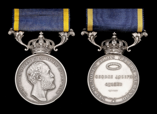 Colour photo of two sides of silver medal on black background, suspended from crown and blue and yellow ribbon. To left, profile of bearded man surrounded by Latin inscription; to right Right side: recipient's name GEORGE JOSEPH STROUD underneath a wreath, also surrounded by a Latin inscription.