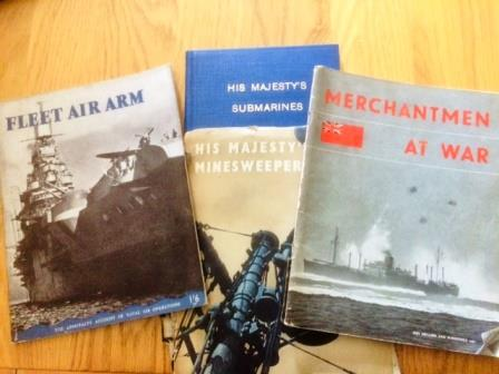 Modern colour photograph of 4 wartime publications, 'Fleet Air Arm', 'His Majesty's Submarines', ' His Majesty's Minesweepers' and 'Merchantmen at War'.
