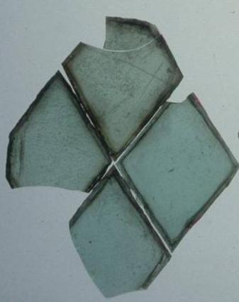 Four broken diamond-shaped panes of glass.