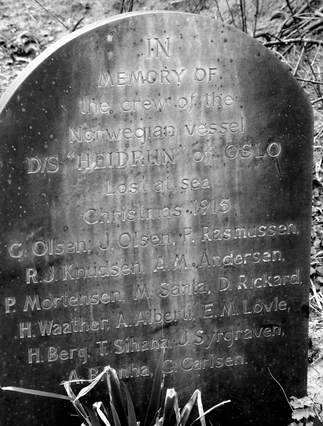 Modern B&W photograph of simple gravestone carved only with text.